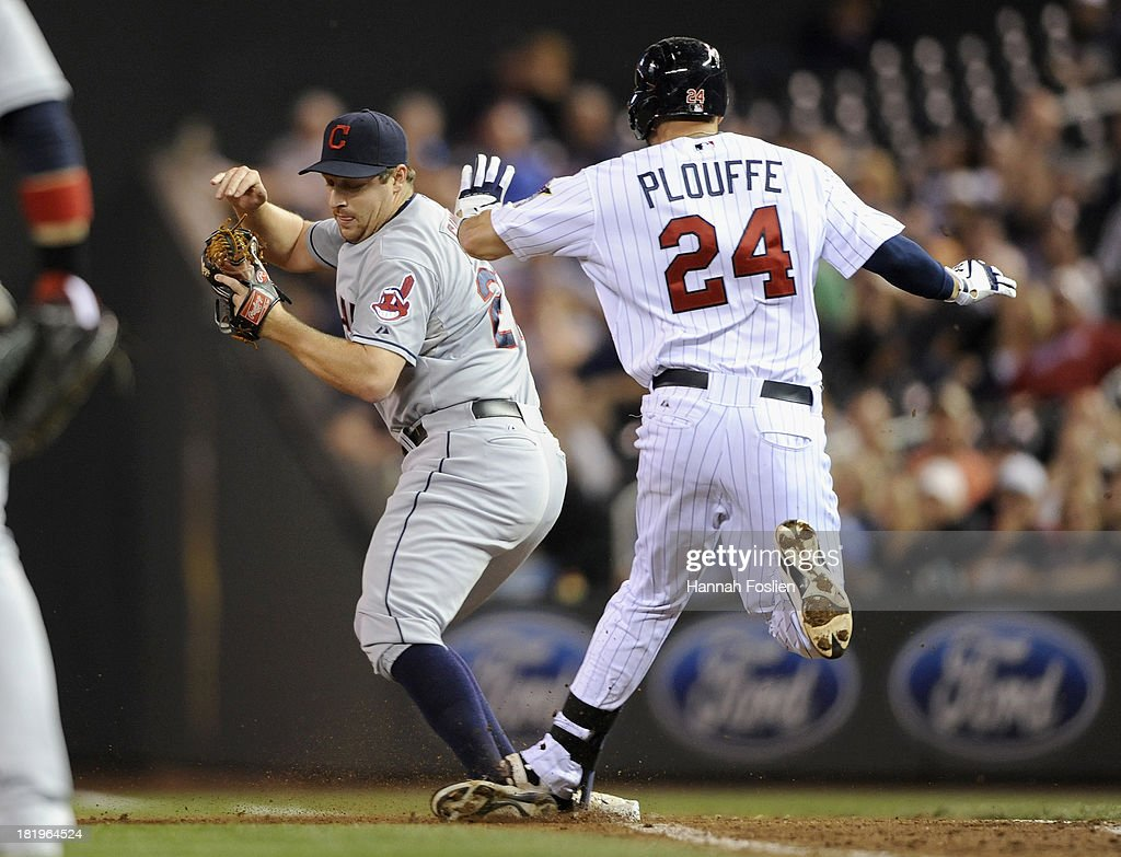 <a gi-track='captionPersonalityLinkClicked' href=/galleries/search?phrase=Trevor+Plouffe&family=editorial&specificpeople=5722348 ng-click='$event.stopPropagation()'>Trevor Plouffe</a> #24 of the Minnesota Twins reaches first base as Bryan Shaw #27 of the Cleveland Indians fields the ball during the sixth inning of the game on September 26, 2013 at Target Field in Minneapolis, Minnesota.