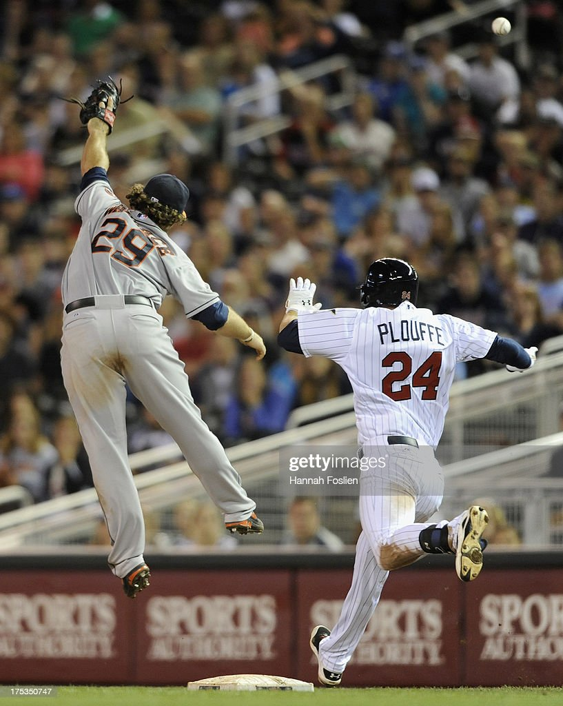 Trevor Plouffe #24 of the Minnesota Twins reaches first base safely as Brett Wallace #29 of the Houston Astros leaps for a ball thrown by teammate Jonathan Villar #6 during the tenth inning of the game on August 2, 2013 at Target Field in Minneapolis, Minnesota. The Twins defeated the Astros 4-3 in thirteen inning.