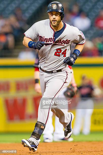 Trevor Plouffe of the Minnesota Twins rounds the bases after hitting a two run home run during the first inning against the Cleveland Indians at...