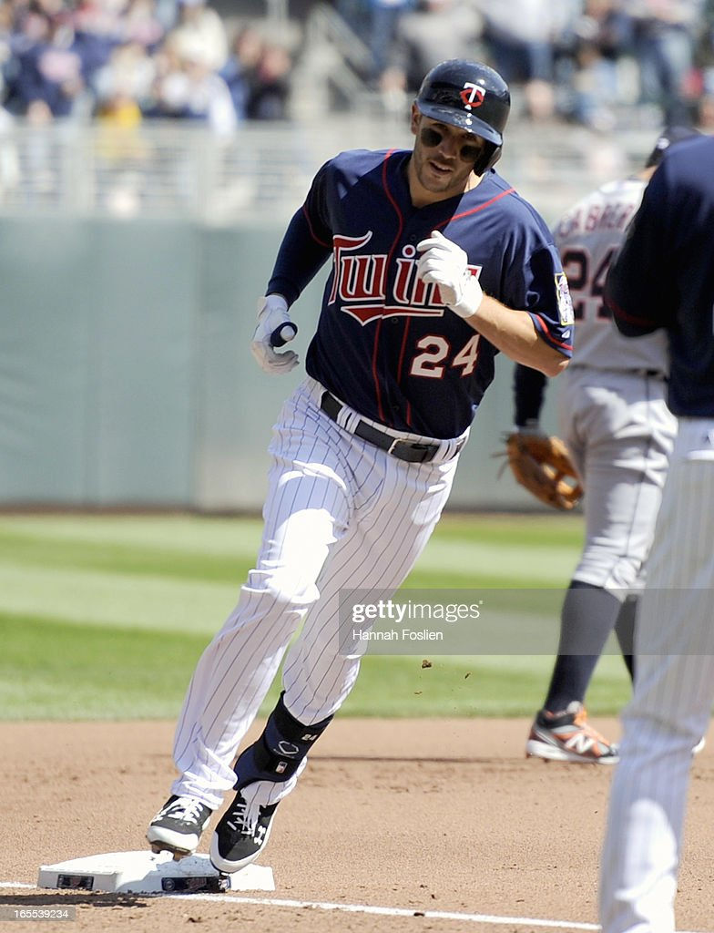 <a gi-track='captionPersonalityLinkClicked' href=/galleries/search?phrase=Trevor+Plouffe&family=editorial&specificpeople=5722348 ng-click='$event.stopPropagation()'>Trevor Plouffe</a> #24 of the Minnesota Twins rounds third base after hitting a solo home run against the Detroit Tigers during the fourth inning of the game on April 4, 2013 at Target Field in Minneapolis, Minnesota.