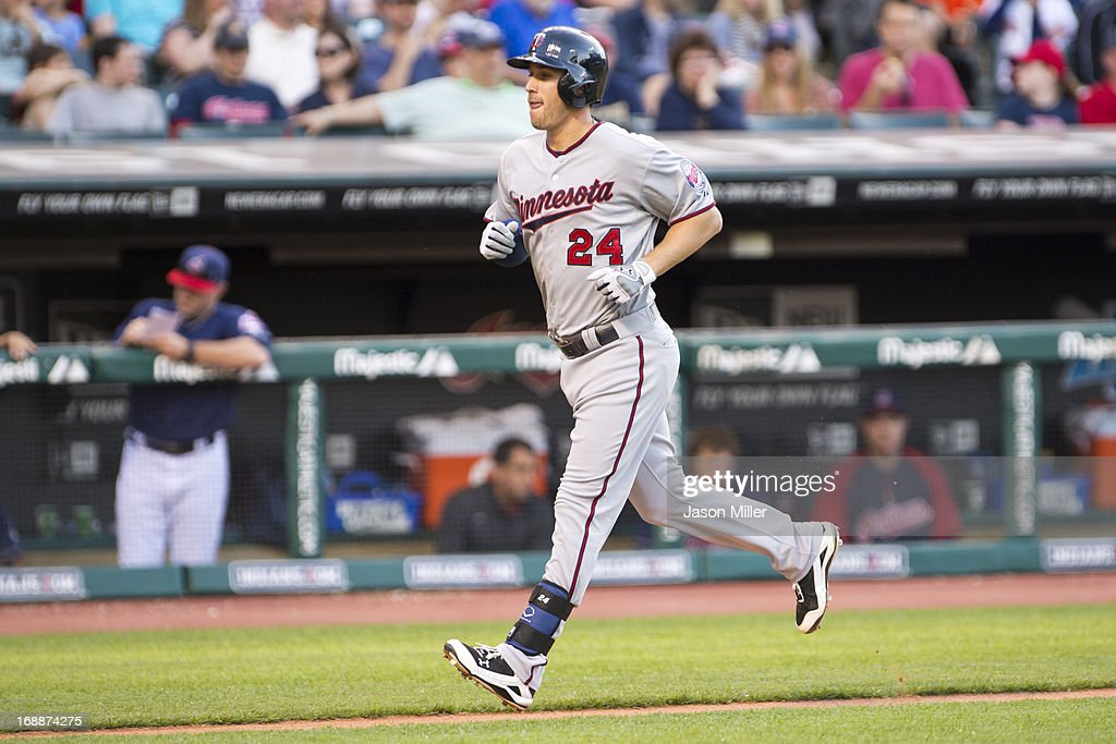 <a gi-track='captionPersonalityLinkClicked' href=/galleries/search?phrase=Trevor+Plouffe&family=editorial&specificpeople=5722348 ng-click='$event.stopPropagation()'>Trevor Plouffe</a> #24 of the Minnesota Twins runs to first after hitting a home run during the second inning against the Cleveland Indians at Progressive Field on May 3, 2013 in Cleveland, Ohio.
