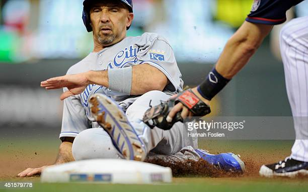 Trevor Plouffe of the Minnesota Twins tags out Raul Ibanez of the Kansas City Royals at third base during the second inning of the game on July 1...