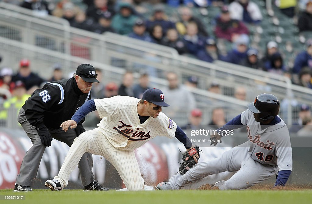 Trevor Plouffe #24 of the Minnesota Twins tags out Torii Hunter #48 of the Detroit Tigers at third base as umpire Jim Joyce #66 looks on during the fifth inning of the game on April 3, 2013 at Target Field in Minneapolis, Minnesota.