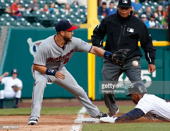 Trevor Plouffe of the Minnesota Twins tries to get a tag down at third base on Anthony Gose of the Detroit Tigers during the fifth inning at Comerica...