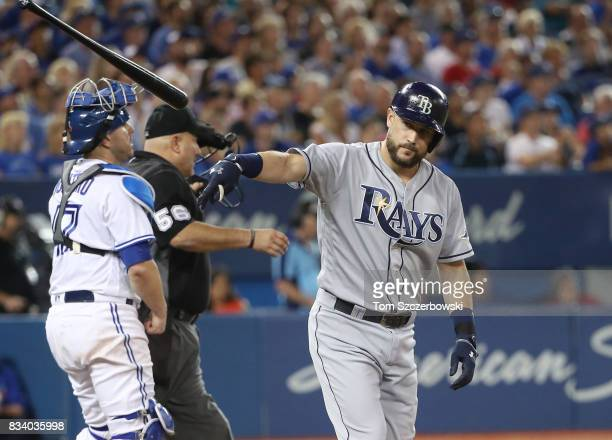 Trevor Plouffe of the Tampa Bay Rays reacts as he pops out with the bases loaded in the sixth inning during MLB game action against the Toronto Blue...