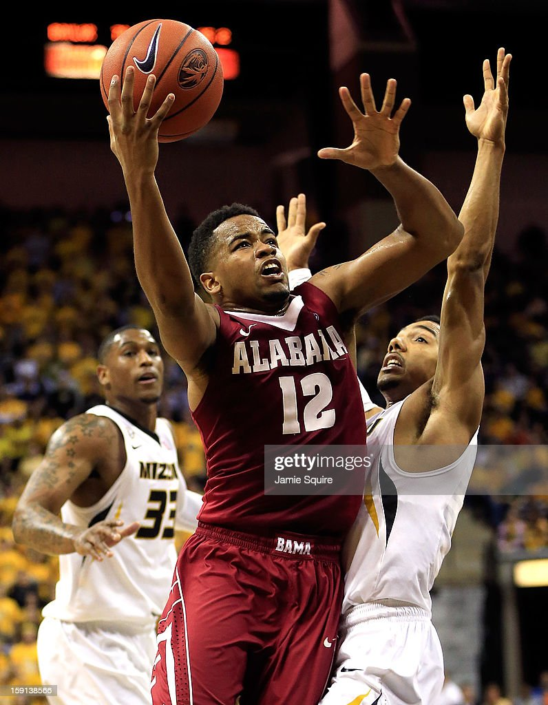 Trevor Releford #12 of the Alabama Crimson Tide shoots over Phil Pressey #1 of the Missouri Tigers as Earnest Ross #33 looks on during the game at Mizzou Arena on January 8, 2013 in Columbia, Missouri.