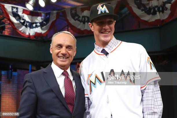 Trevor Rogers poses for a photo with Major League Baseball Commissioner Robert D Manfred Jr after being selected 13th overall by the Miami Marlins...
