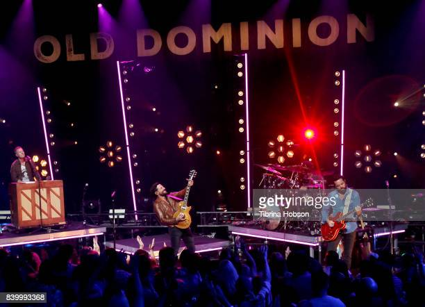 Trevor Rosen Matthew Ramsey and Brad Tursi of Old Dominion perform at the iHeartCountry album release party with Old Dominion at iHeartRadio Theater...