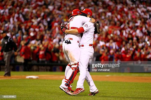 Trevor Rosenthal and catcher Yadier Molina of the St Louis Cardinals celebrate after the Cardinals defeat the Los Angeles Dodgers 90 in Game Six of...
