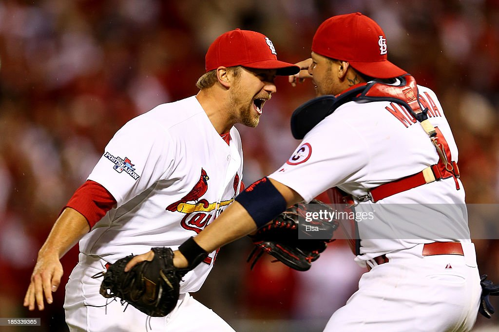 Trevor Rosenthal #26 and catcher Yadier Molina #4 of the St. Louis Cardinals celebrate after the Cardinals defeat the Los Angeles Dodgers 9-0 in Game Six of the National League Championship Series at Busch Stadium on October 18, 2013 in St Louis, Missouri.