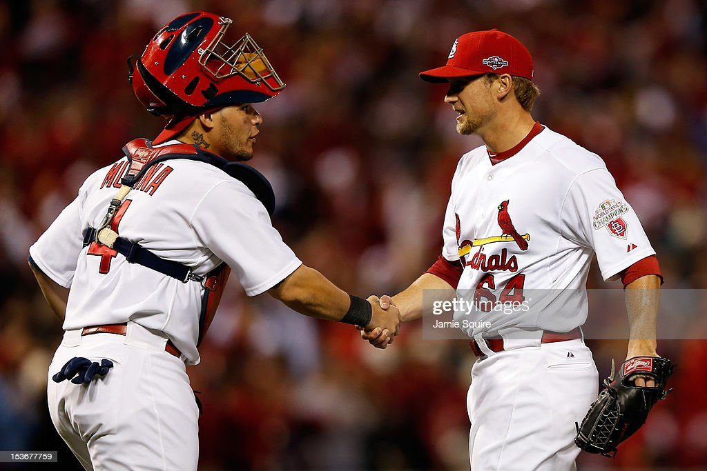 Trevor Rosenthal #64 and <a gi-track='captionPersonalityLinkClicked' href=/galleries/search?phrase=Yadier+Molina&family=editorial&specificpeople=172002 ng-click='$event.stopPropagation()'>Yadier Molina</a> #4 of the St. Louis Cardinals celebrate after the Cardinals defeat the Washington Nationals 12-4 in Game Two of the National League Division Series at Busch Stadium on October 8, 2012 in St Louis, Missouri.