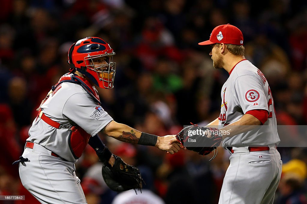 <a gi-track='captionPersonalityLinkClicked' href=/galleries/search?phrase=Trevor+Rosenthal&family=editorial&specificpeople=9003011 ng-click='$event.stopPropagation()'>Trevor Rosenthal</a> #26 and <a gi-track='captionPersonalityLinkClicked' href=/galleries/search?phrase=Yadier+Molina&family=editorial&specificpeople=172002 ng-click='$event.stopPropagation()'>Yadier Molina</a> #4 of the St. Louis Cardinals celebrate after defeating the Boston Red Sox 4-2 in Game Two of the 2013 World Series at Fenway Park on October 24, 2013 in Boston, Massachusetts.