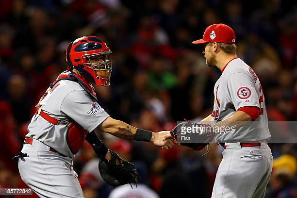 Trevor Rosenthal and Yadier Molina of the St Louis Cardinals celebrate after defeating the Boston Red Sox 42 in Game Two of the 2013 World Series at...