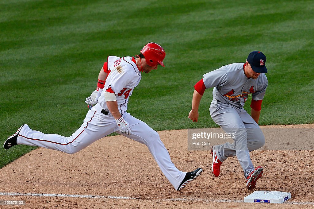 Trevor Rosenthal #64 of the St. Louis Cardinals beats <a gi-track='captionPersonalityLinkClicked' href=/galleries/search?phrase=Bryce+Harper&family=editorial&specificpeople=5926486 ng-click='$event.stopPropagation()'>Bryce Harper</a> #34 of the Washington Nationals to the bag for an out in the sixth inning during Game Three of the National League Division Series at Nationals Park on October 10, 2012 in Washington, DC.