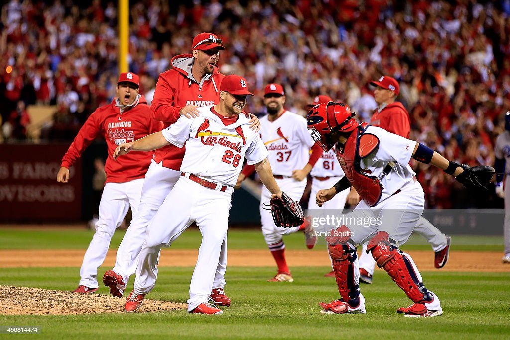 <a gi-track='captionPersonalityLinkClicked' href=/galleries/search?phrase=Trevor+Rosenthal&family=editorial&specificpeople=9003011 ng-click='$event.stopPropagation()'>Trevor Rosenthal</a> #26 of the St. Louis Cardinals celebrates with teammates after defeating the Los Angeles Dodgers in Game Four of the National League Divison Series at Busch Stadium on October 7, 2014 in St Louis, Missouri.