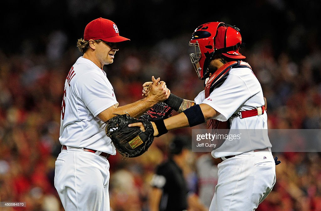 <a gi-track='captionPersonalityLinkClicked' href=/galleries/search?phrase=Trevor+Rosenthal&family=editorial&specificpeople=9003011 ng-click='$event.stopPropagation()'>Trevor Rosenthal</a> #26 of the St. Louis Cardinals celebrates with <a gi-track='captionPersonalityLinkClicked' href=/galleries/search?phrase=Yadier+Molina&family=editorial&specificpeople=172002 ng-click='$event.stopPropagation()'>Yadier Molina</a> #4 after defeating the Washington Nationals at Busch Stadium on June 13, 2014 in St. Louis, Missouri.
