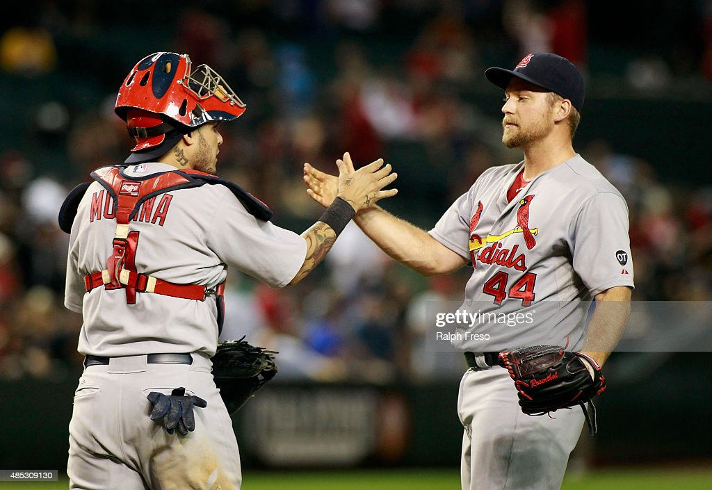 Trevor Rosenthal #44 of the St Louis Cardinals is congratulated by teammate Yadier Molina #4 after pitching the ninth inning for a save against the Arizona Diamondbacks during a MLB game at Chase Field on August 26, 2015 in Phoenix, Arizona. The Cardinals defeated the Diamondbacks 3-1.