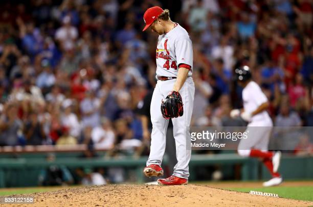 Trevor Rosenthal of the St Louis Cardinals reacts after Xander Bogaerts of the Boston Red Sox hit a home run during the ninth inning at Fenway Park...