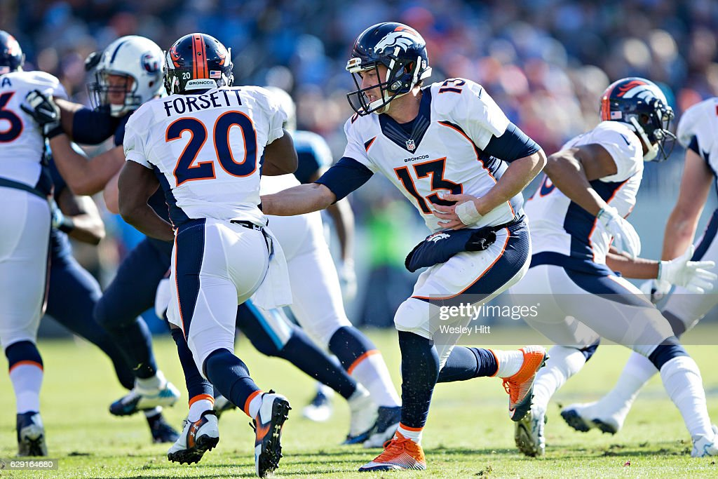 Trevor Siemian #13 hands off the ball to Justin Forsett #20 of the Denver Broncos during a game against the Tennessee Titans at Nissan Stadium on December 11, 2016 in Nashville, Tennessee. The Titans defeated the Broncos 13-10.