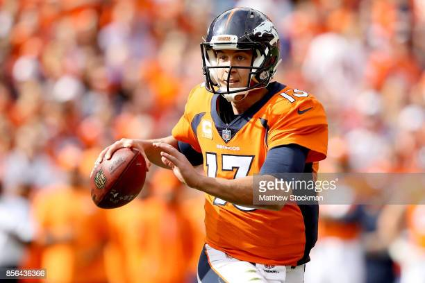 Trevor Siemian of the Denver Broncos rolls out of the pocket against the Oakland Raiders at Sports Authority Field at Mile High on October 1 2017 in...