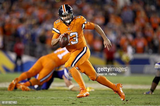 Trevor Siemian of the Denver Broncos runs with the ball during the first half of a game against the San Diego Chargers at Qualcomm Stadium on October...