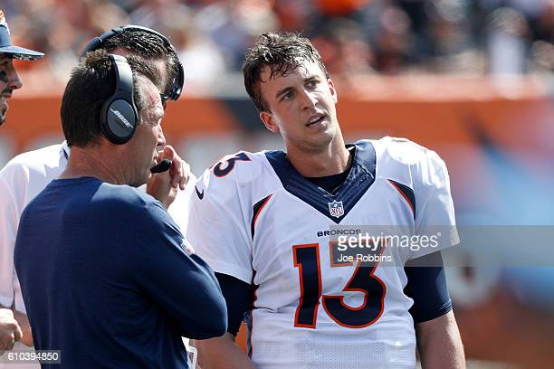 Trevor Siemian of the Denver Broncos talks with Head Coach Gary Kubiak of the Denver Broncos on the sidelines during the second quarter of the game...
