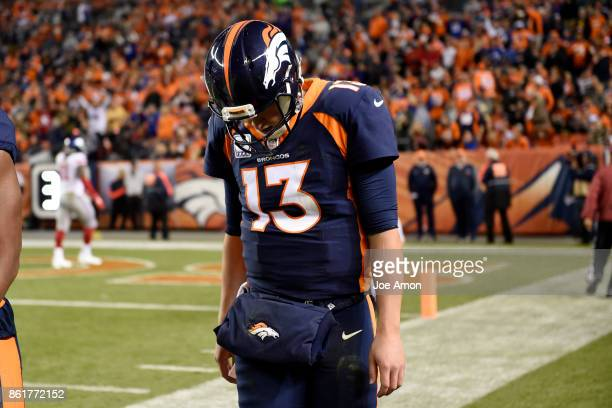 Trevor Siemian of the Denver Broncos walks off the field after throwing a pick six to Janoris Jenkins of the New York Giants during the second...