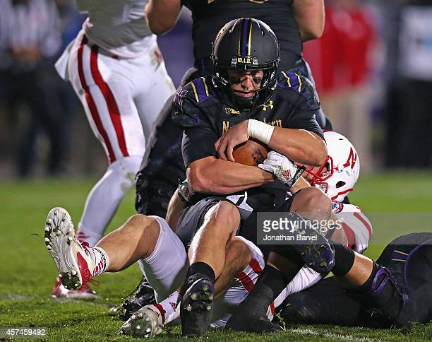 Trevor Siemian of the Northwestern Wildcats is sacked by Trevor Roach of the Nebraska Cornhuskers at Ryan Field on October 18 2014 in Evanston...