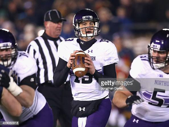 Trevor Siemian of the Northwestern Wildcats looks for a receiver against the Notre Dame Fighting Irish at Notre Dame Stadium on November 15 2014 in...