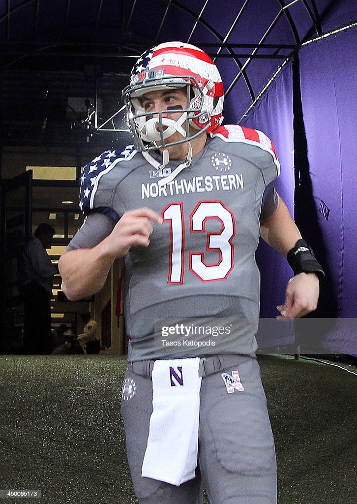 Trevor Siemian #13 of the Northwestern Wildcats takes the field with there Wounded Warrior Project uniform before they take on Michigan Wolverines at Ryan Field on November 16, 2013 in Evanston, Illinois.
