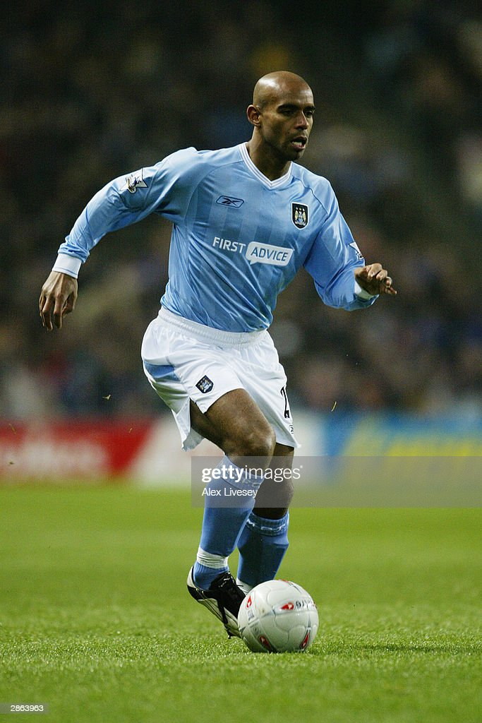 Trevor Sinclair of Manchester City running with the ball at his feet during the FA Cup third round match between Manchester City and Leicester City on January 3, 2004 at the City of Manchester Stadium in Manchester, England. The match finished in a 2-2 draw.