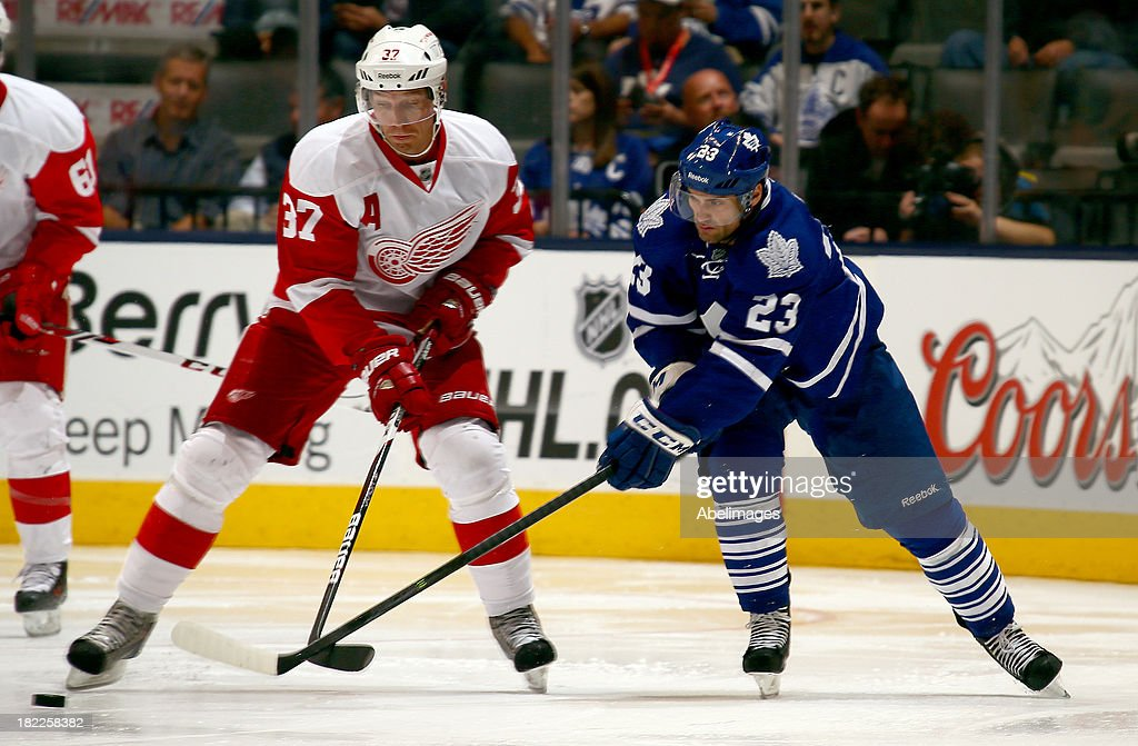 Trevor Smith #23 of the Toronto Maple Leafs chases down Mikael Samuelsson #37 of the Detroit Red Wings during NHL Preseason action at the Air Canada Centre September 28, 2013 in Toronto, Ontario, Canada.