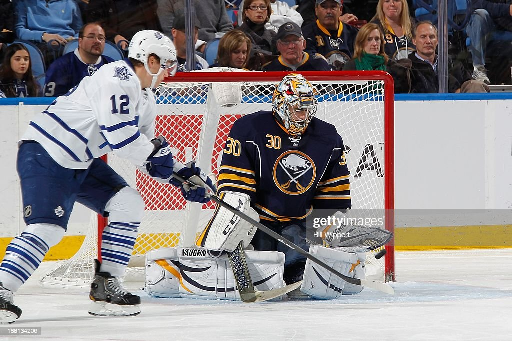 Trevor Smith #23 (not pictured) of the Toronto Maple Leafs scores a second period goal against Ryan Miller #30 of the Buffalo Sabres as <a gi-track='captionPersonalityLinkClicked' href=/galleries/search?phrase=Mason+Raymond&family=editorial&specificpeople=4521385 ng-click='$event.stopPropagation()'>Mason Raymond</a> #12 of the Leafs screens the shot on November 15, 2013 at the First Niagara Center in Buffalo, New York.