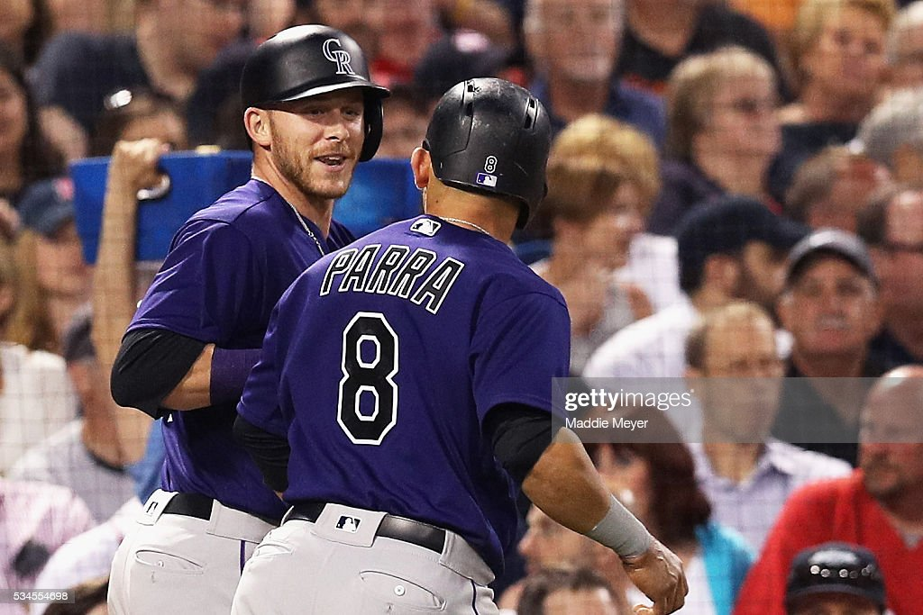 Trevor Story #27 of the Colorado Rockies and Gerardo Parra #8 celebrate after Story's two run homer against the Boston Red Sox during the fifth inning at Fenway Park on May 26, 2016 in Boston, Massachusetts.
