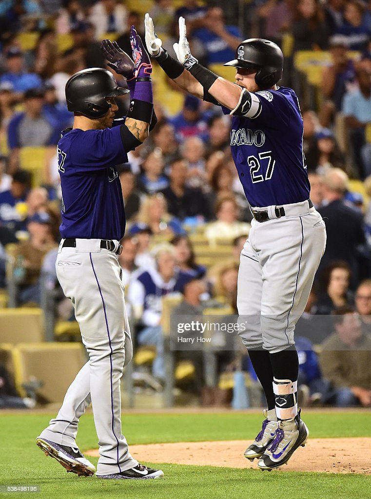 <a gi-track='captionPersonalityLinkClicked' href=/galleries/search?phrase=Trevor+Story&family=editorial&specificpeople=13669220 ng-click='$event.stopPropagation()'>Trevor Story</a> #27 of the Colorado Rockies celebrates his three run homerun to take a 6-1 lead over the Los Angeles Dodgers with <a gi-track='captionPersonalityLinkClicked' href=/galleries/search?phrase=Carlos+Gonzalez+-+US+Baseball+Player&family=editorial&specificpeople=7204259 ng-click='$event.stopPropagation()'>Carlos Gonzalez</a> #5 during the sixth inning at Dodger Stadium on June 6, 2016 in Los Angeles, California.