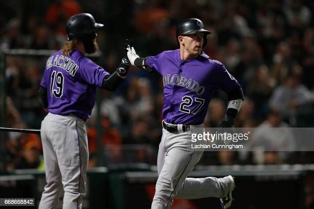 Trevor Story of the Colorado Rockies celebrates with Charlie Blackmon of the Colorado Rockies after scoring a run in the fifth inning against the San...