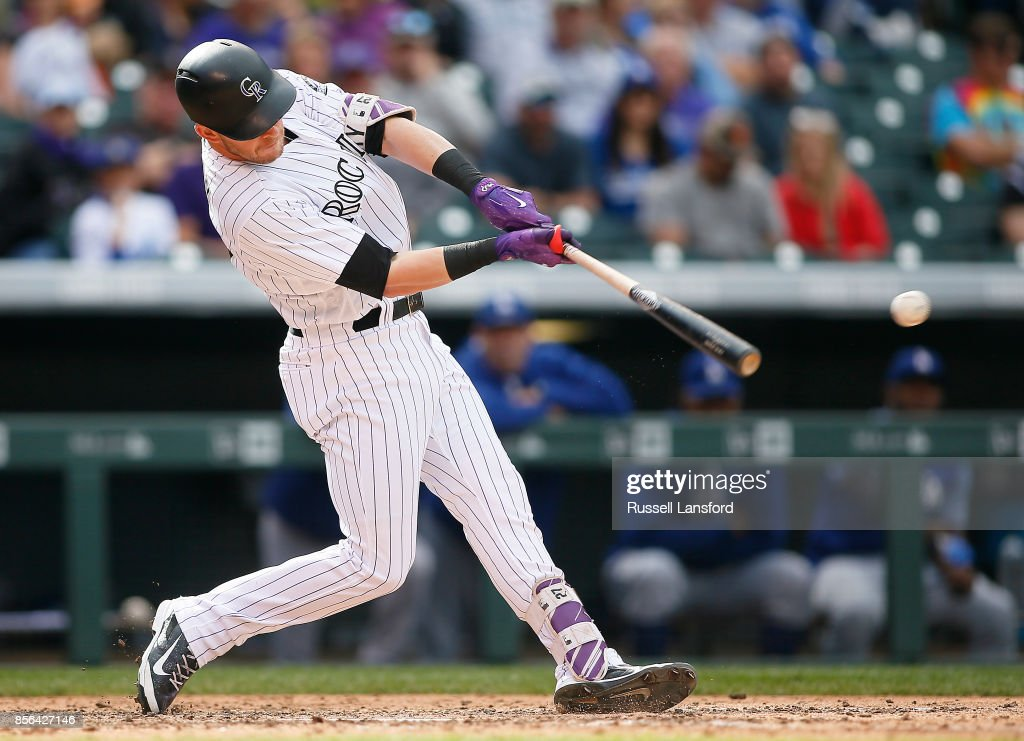 Trevor Story #27 of the Colorado Rockies connects for a double in the sixth inning against the Los Angeles Dodgers at Coors Field on October 1, 2017 in Denver, Colorado.