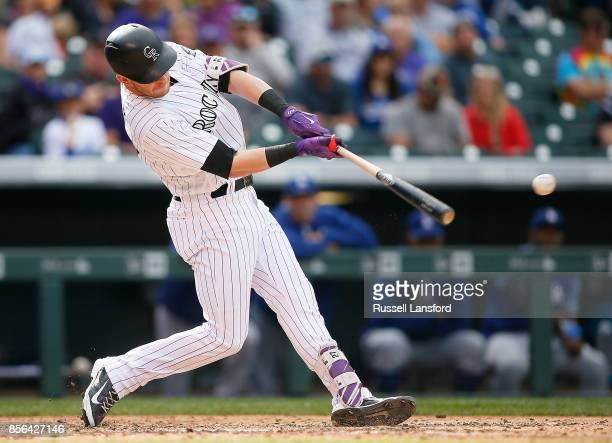 Trevor Story of the Colorado Rockies connects for a double in the sixth inning against the Los Angeles Dodgers at Coors Field on October 1 2017 in...