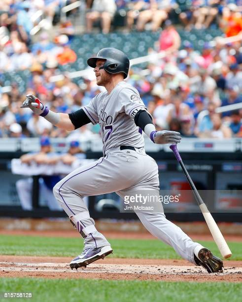 Trevor Story of the Colorado Rockies follows through on a first inning two run double against the New York Mets on July 16 2017 at Citi Field in the...
