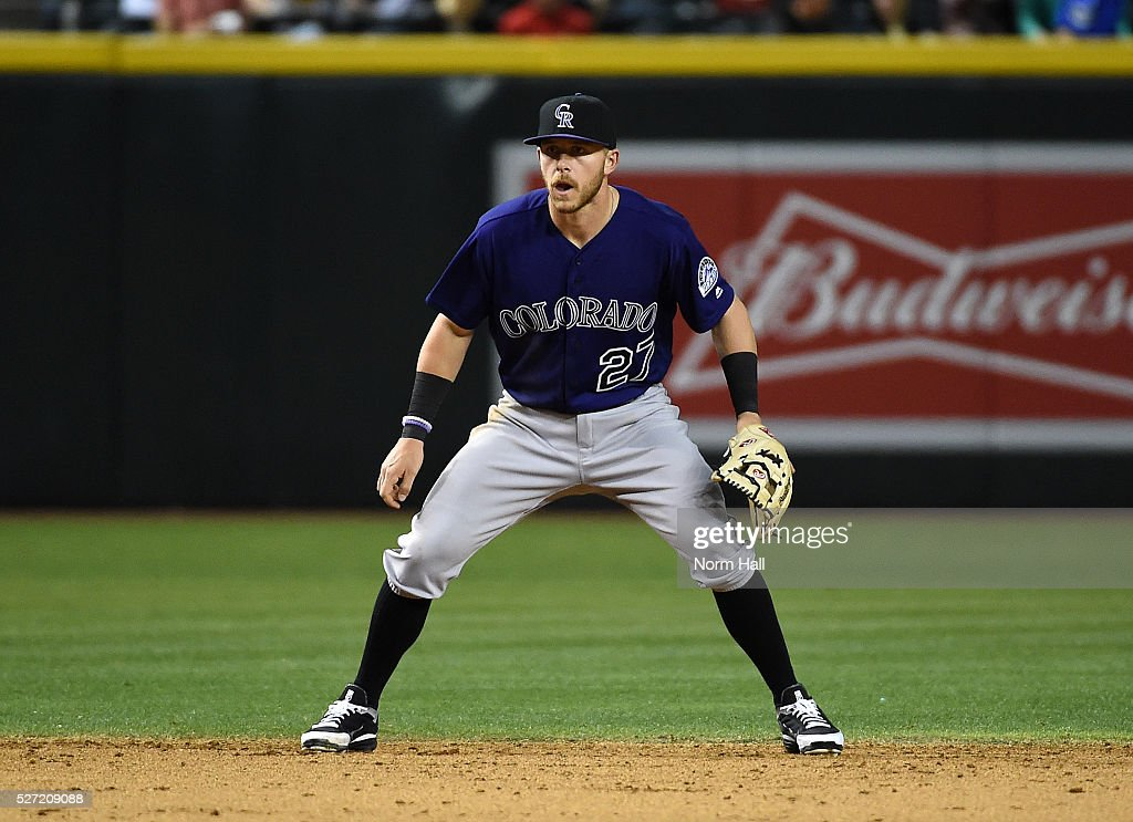 <a gi-track='captionPersonalityLinkClicked' href=/galleries/search?phrase=Trevor+Story&family=editorial&specificpeople=13669220 ng-click='$event.stopPropagation()'>Trevor Story</a> #27 of the Colorado Rockies gets ready to make a play at shortstop against the Arizona Diamondbacks on April 29, 2016 in Phoenix, Arizona.