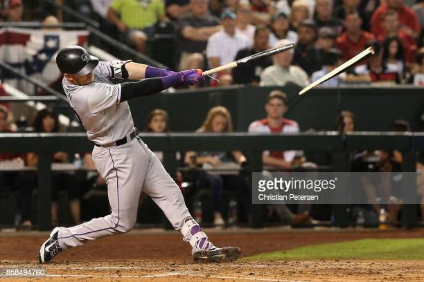 Trevor Story of the Colorado Rockies hits a broken bat single during the fourth inning of the National League Wild Card game against the Arizona...