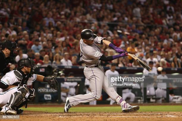 Trevor Story of the Colorado Rockies hits a brokenbat single during the top of the fourth inning of the National League Wild Card game against the...