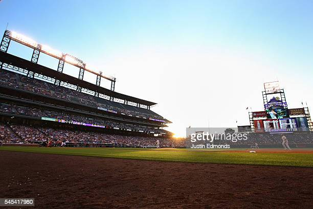 Trevor Story of the Colorado Rockies hits a solo home run off of Adam Morgan of the Philadelphia Phillies during the fifth inning at Coors Field on...