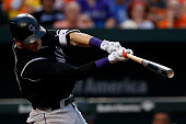 Trevor Story of the Colorado Rockies hits a two run RBI single in the third inning against the Baltimore Orioles at Oriole Park at Camden Yards on...