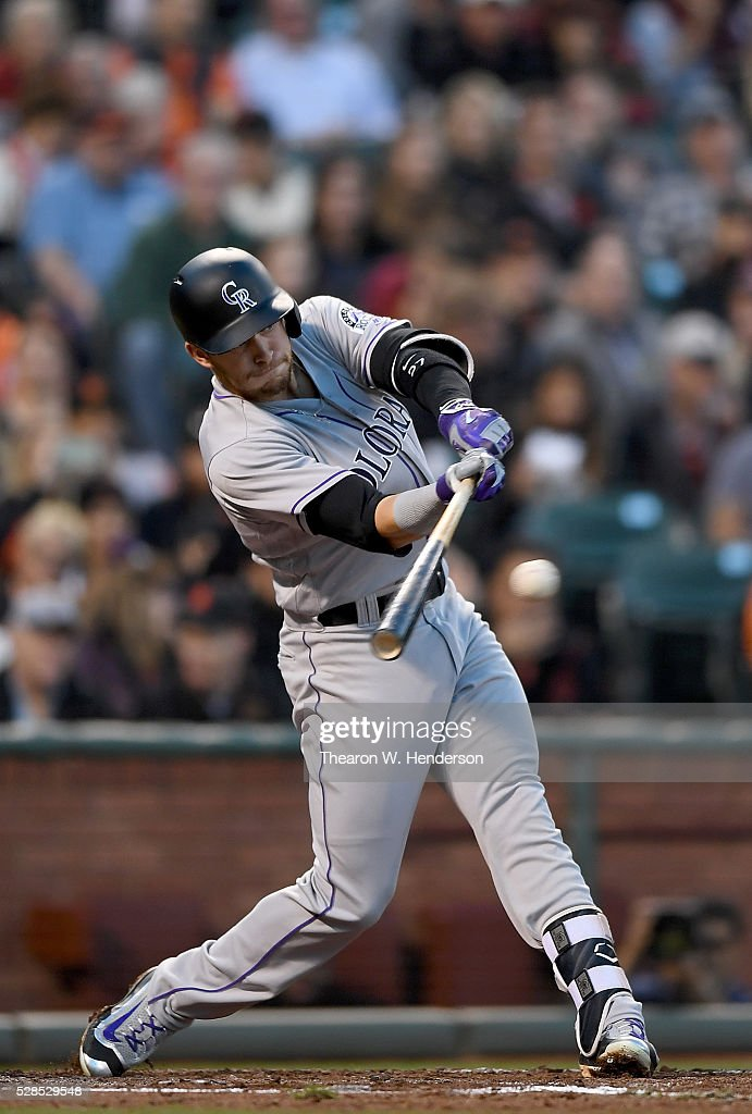 Trevor Story #27 of the Colorado Rockies hits an RBI single scoring DJ LeMahieu #9 against the San Francisco Giants in the top of the second inning at AT&T Park on May 5, 2016 in San Francisco, California.