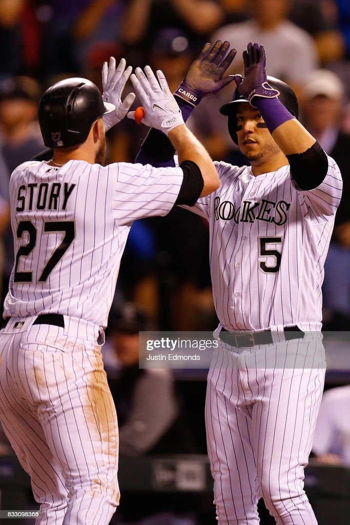 Trevor Story #27 of the Colorado Rockies is congratulated by Carlos Gonzalez #5 after hitting a two-run home run during the fourth inning against the Atlanta Braves at Coors Field on August 16, 2017 in Denver, Colorado.