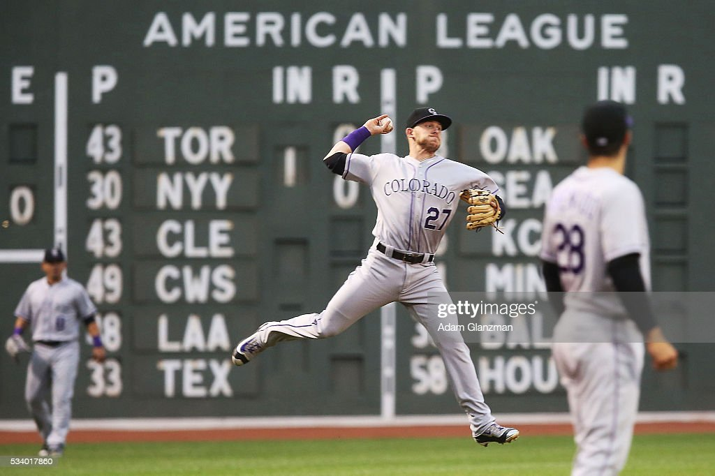 Trevor Story #27 of the Colorado Rockies makes a throw to first base in the first inning during the game against the Boston Red Sox at Fenway Park on May 24, 2016 in Boston, Massachusetts.