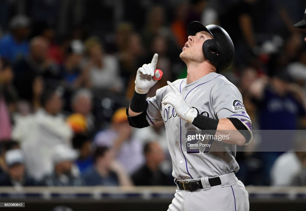 Trevor Story #27 of the Colorado Rockies points skyward after hitting a solo home run during the seventh inning of a baseball game against the San Diego Padres at PETCO Park on September 22, 2017 in San Diego, California.