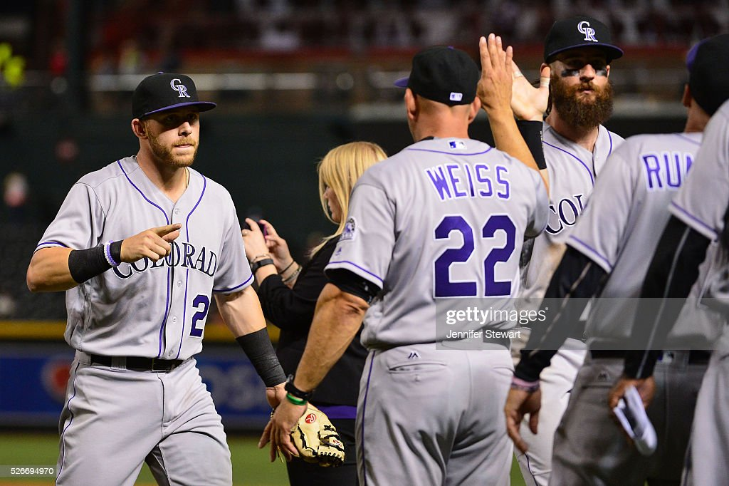 Trevor Story #27 of the Colorado Rockies points to manager Walt Weiss #22 after closing out the game against the Arizona Diamondbacks at Chase Field on April 30, 2016 in Phoenix, Arizona. The Colorado Rockies won 5-2.