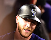 Trevor Story of the Colorado Rockies reacts after his three run homerun to take a 61 lead over the Los Angeles Dodgers during the sixth inning at...
